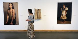 Maura Tamez with her artwork in Storytellers, at the Kelowna Art Gallery